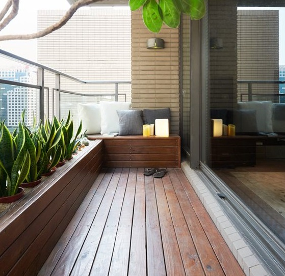 Reformar tu terraza. Terraza revestida con madera