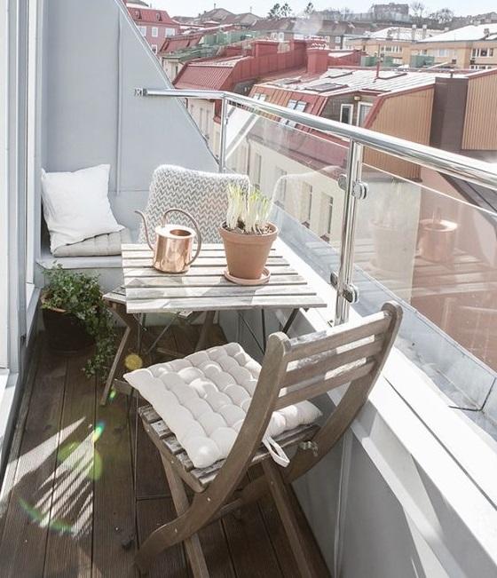 Reformar tu terraza. Terraza con antepecho de cristal